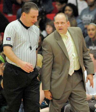 Reagan head coach Terry Barton, right, argues a call with the referee during a girls' high school basketball playoff game against Steele, Tuesday, Feb. 21, 2012, at Judson High School in Converse, Texas. Photo: Darren Abate, Express-News