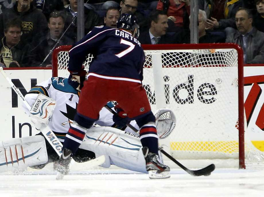 Columbus Blue Jackets' Jeff Carter (7) scores his third goal of the night, past San Jose Sharks goalie Thomas Greiss (1) during the third period of an NHL hockey game, Tuesday, Feb. 21, 2012, in Columbus, Ohio. Blue Jackets won 6-3. (AP Photo/Terry Gilliam) Photo: Terry Gilliam, Associated Press
