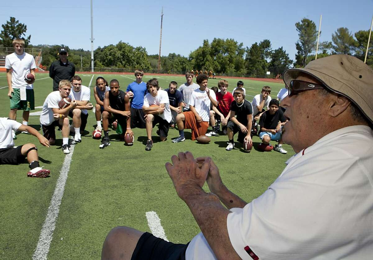 Football coach, Tom Martinez, right, who has worked with such quarterbacks as Super Bowl winner Tom Brady instructs high school students during his football/quarterback camp at Woodside High in Woodside, Calif. on Saturday, June 25, 2011. Martinez has been ailing, and is likely to be getting a kidney transplant in near future. Kat Wade / Special to the Chronicle