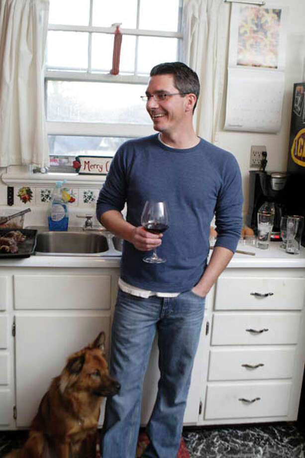 Executive chef at Creo, Brian Bowden shares a modest Troy apartment with his girlfriend Carly Mankouski and their dog, Ralph. He says his kitchen is the best of anyplace he's ever lived. Read the story  here Get the Chef's recipes  here Photo: (Photo By Suzanne Kawola/Life@Home)