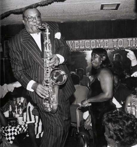 "Grady Gaines performs at the Silver Slipper club. (Photo from ""Down In Houston: Bayou City Blues,'' by Roger Wood, photographed by James Fraher.) Photo: James Fraher / University of Texas Press"
