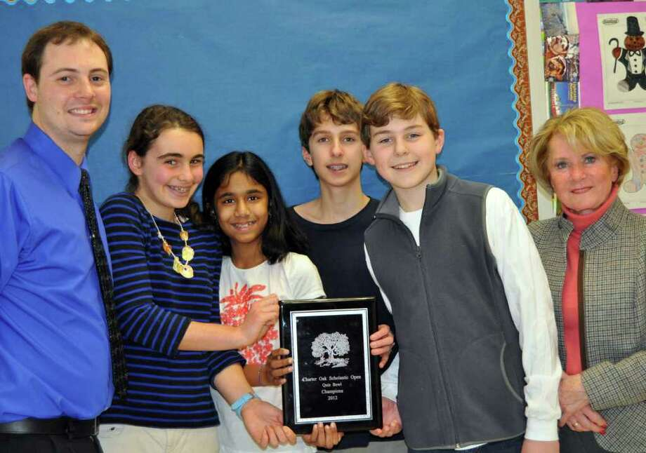 Pictured  is the first place Charter Oak champion team with MMS Quiz Bowl coordinators Ken Romeo and Barbara Ivey. From left are Romeo, Sarah LeHan, Sarishka Desai, Michael Borecki, Porter Bowman and Ivey. Photo: Contributed Photo