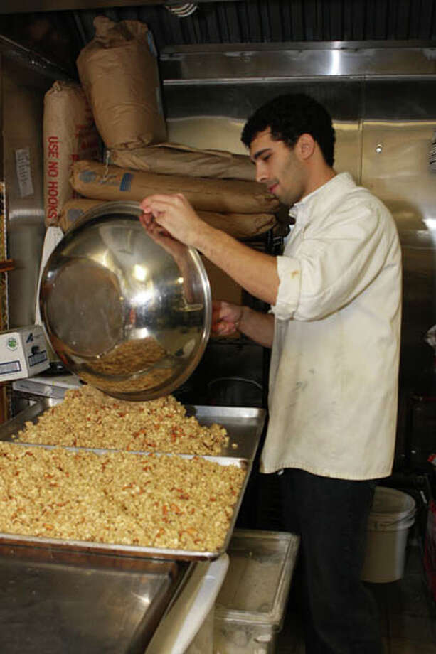 Alessandro Gerbini enjoyed his mom's homemade granola during long hours of studying at RPI. Now 24, he heads up Gatherer's Gourmet Granola, featuring gluten-free, locally-sourced, all-natural ingredients, everything mixed by hand. Read the story  here Photo: Krishna Hill, (Photo By Krishna Hill/Life@Home)