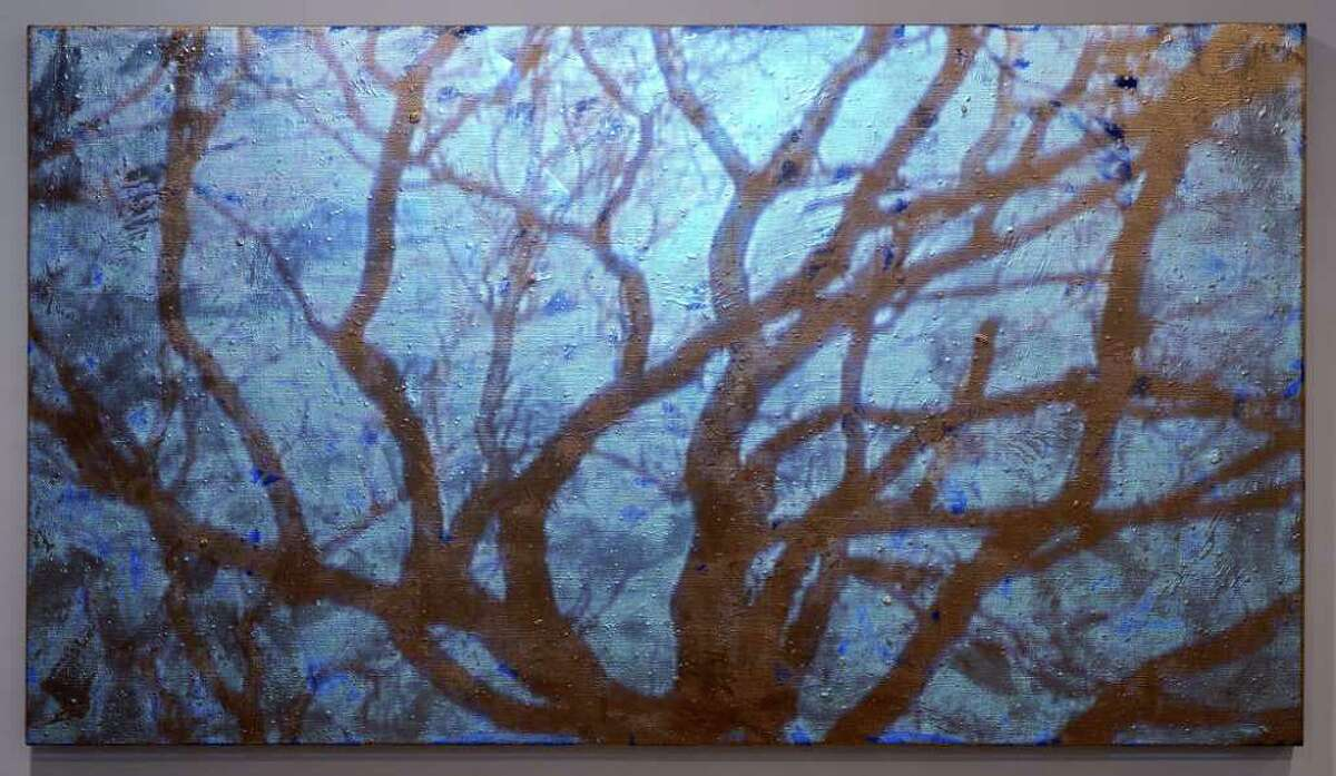 SKIDMORE COLLEGE ?GOLD/BLUE SKY? (2003, video projection, oil and enamel on linen) is among the works in ?Donald Moffett: The Extravagant Vein? at the Tang Museum of Skidmore College, starting Saturday.