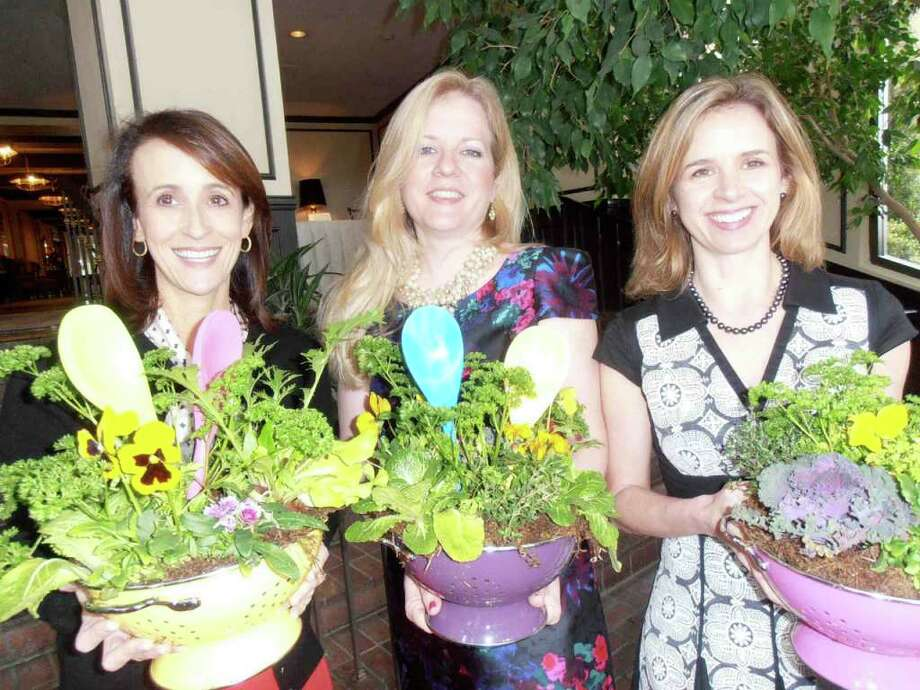 "Lisa Sechler, from left, and event co-chairs Heather Kraft and Gretchen Herrmann show off edible centerpieces at Pi Beta Phi's Alumnae Club Foundation's ""Gourmet Soiree"" with New Orleans chef John Besh. Photo: Nancy Cook-Monroe, For The Express-News"