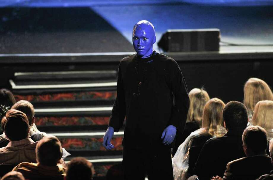 At various time in the show, Blue Man performers come into the audience, interacting with the crowd. Photo: Robin Jerstad, For The Express-News