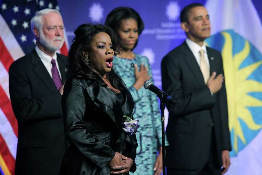 WASHINGTON, DC - FEBRUARY 22:  Singer Denyce Graves (2nd L) sings the national anthem as U.S. Presid