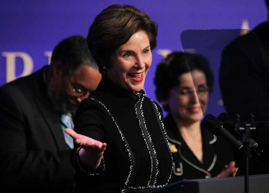 WASHINGTON, DC - FEBRUARY 22:  Former U.S. first lady Laura Bush acknowledges the audience during the groundbreaking ceremony of the National Museum of African American History and Culture February 22, 2012 in Washington, DC. According to a Smithsonian news release, the 380,000-square-foot museum, located at the corner of 15th Street NW and Constitution Avenue and will be opened to the public in 2015, will house public spaces, including exhibition halls, an auditorium and a cafe; offices; and an education center. Photo: Alex Wong, Getty Images / 2012 Getty Images