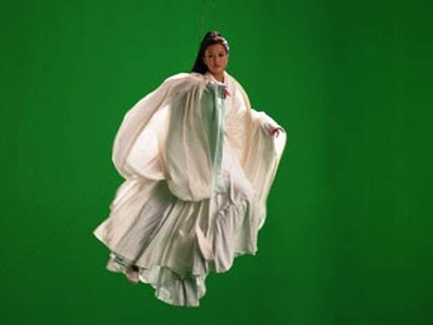 "The ""green screen goddess"" is featured in British artist Isaac Julien's multiscreen work ""Ten Thousand Waves."" Photo: Courtesy Isaac Julien"