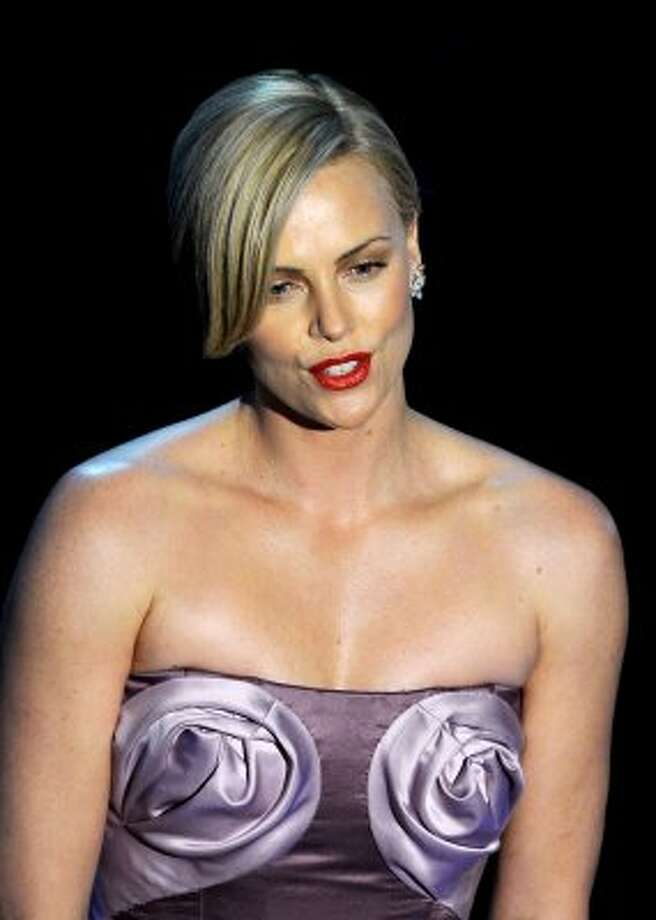 Charlize Theron's bosom was covered by fabric swirls that look like giant cinnamon rolls in 2010. (Photo by Gabriel BouysAFP/Getty Images) (GABRIEL BOUYS / AFP/Getty Images)