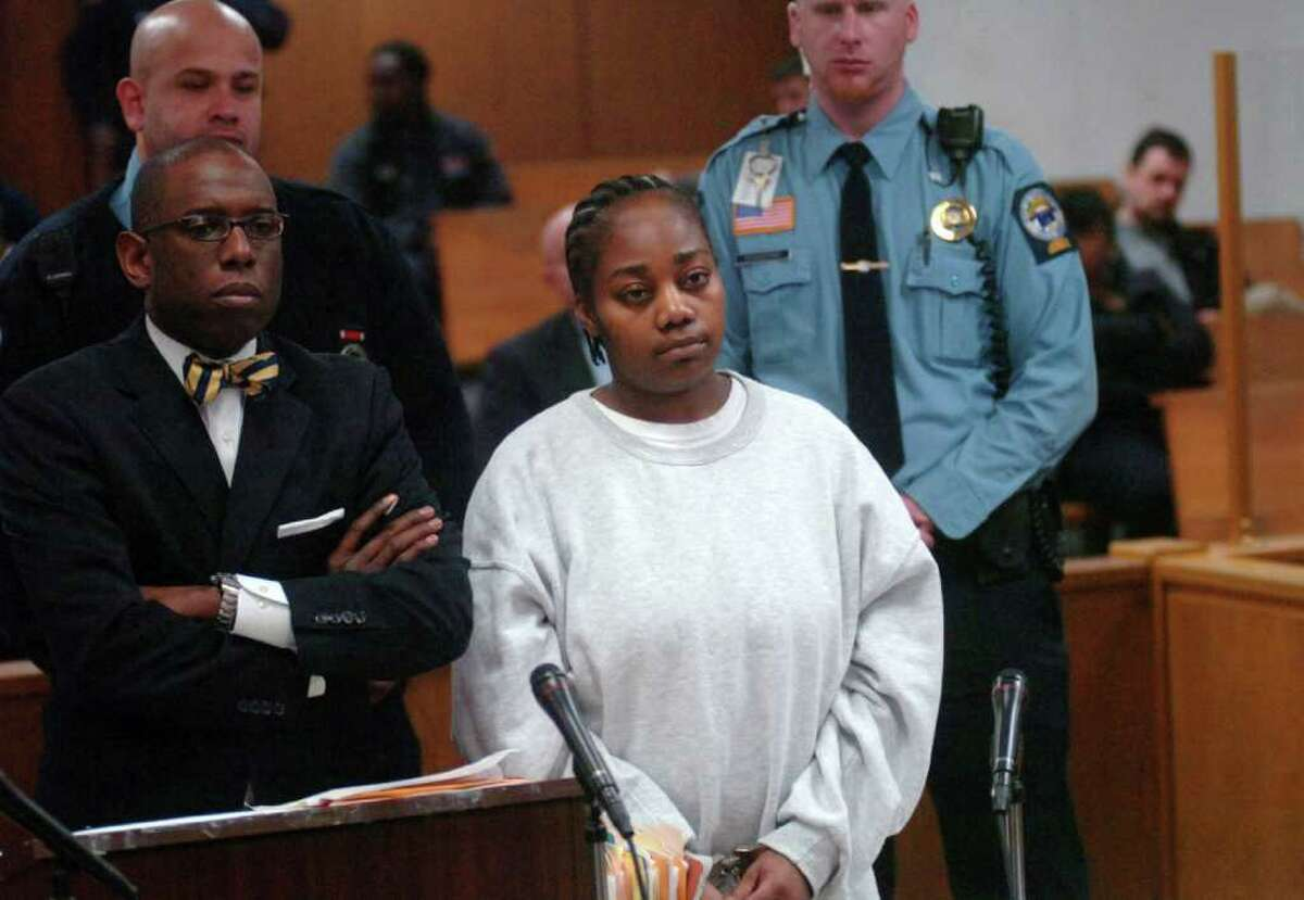 Tanya McDowell stands with her defense attorney, Darnell Crosland, during her appearance in Superior Court in Norwalk, Conn. on Wednesday, Feb. 22, 2012. McDowell, the Bridgeport mom arrested in April 2011 and charged with first-degree larceny for sending her then 5-year-old son to a Norwalk elementary school, will serve five years in prison and another five years of probation after pleading guilty to the larceny charge. McDowell will be issued a 12-year sentence suspended after five years. She also pleaded guilty to four counts of sale of narcotics -- counts that will be included in her prison sentence.