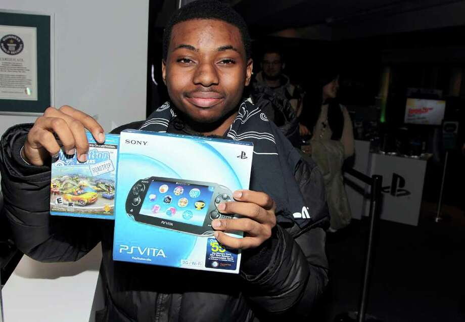 COMMERCIAL IMAGE - In this photo taken by AP Images for Sony Computer Entertainment America, Martin Treherne shows off his PlayStation Vita during the PlayStation Vita Launch on Wednesday Feb. 22, 2012 in New York. Photo: AP Images For Sony Computer Entertainment America