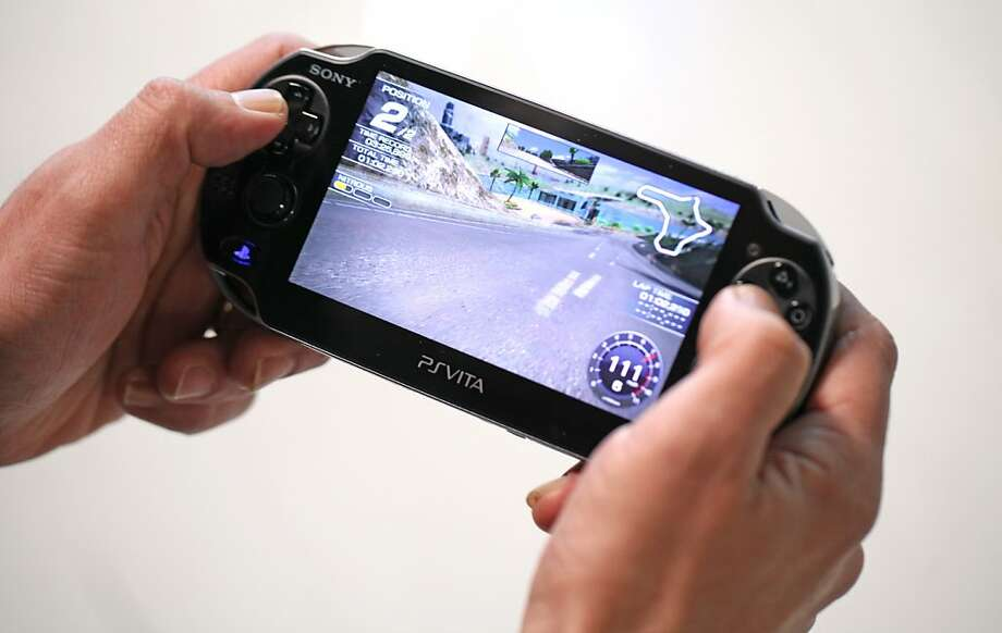 "A man plays the game Ridgeracer on a Sony Corp.PlayStation Vita games console in London, U.K., on Tuesday, Feb. 21, 2012. Sony  Corp. incoming Chief Executive Officer Kazuo Hirai said he will make ""a hard, painful decision"" to cut costs in the TV business and supply chain to turn around a company facing a fourth straight annual loss. Photographer: Chris Ratcliffe/Bloomberg Photo: Chris Ratcliffe, Bloomberg"