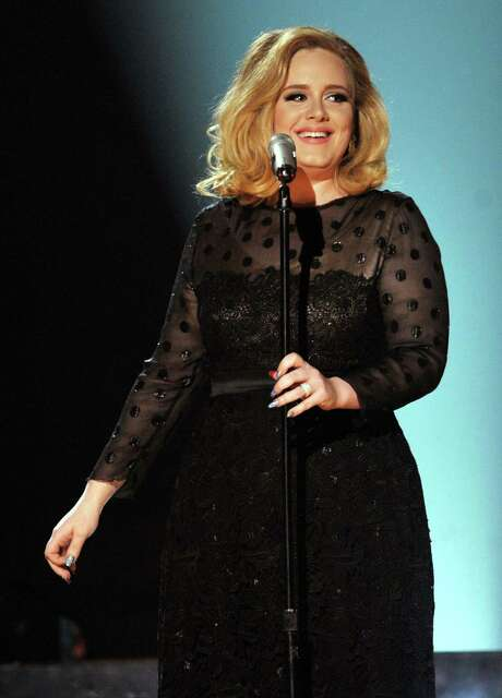 """Grammy-winning singer Adele takes the stage for a performance at London's Royal Albert Hall and is interviewed by Matt Lauer in """"Adele Live in London."""" The special airs at 7 p.m. Sunday on NBC. Photo: Kevin Winter / 2012 Getty Images"""