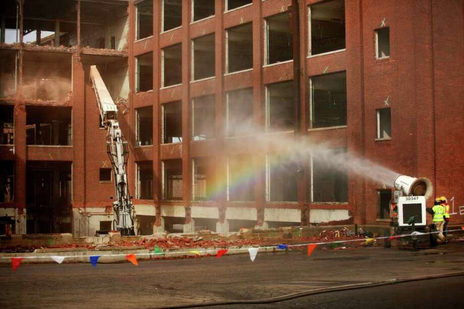 A rainbow hangs in the mist of a snowmaking machine, converted for use as dust control, as deconstruction continues on the General Electric factory on Boston Avenue in Bridgeport on Wednesday, February 22, 2012. Photo: Brian A. Pounds / Connecticut Post