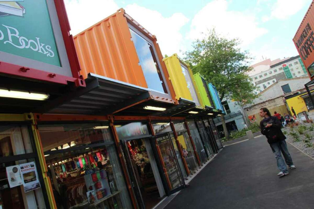 Pedestrians browse shops in the rebuilt City Mall in Christchurch in which most of the 27 shops are built from cargo shipping containers. Cashel Street had been the site of the former pedestrian City Mall, but all the businesses had to be demolished after the Feb. 22, 2011, earthquake.