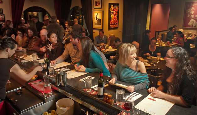 Customers enjoy dinner and drinks at Rosso Pizzeria in Santa Rosa, Calif., on Saturday, February 18th, 2012. Photo: John Storey