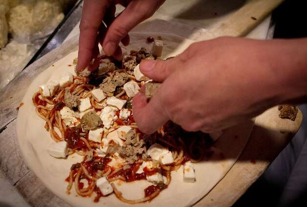"The ""Goomba"" pizza being made at Rosso Pizzeria in Santa Rosa, Calif., on Saturday, February 18th, 2012. Photo: John Storey"
