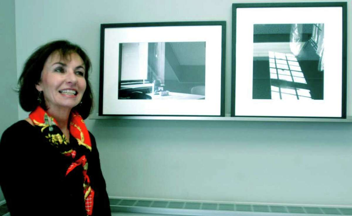 SPECTRUM/Images by Sherman photographer Cynthia O'Connor are among the artwork now gracing the halls of Mallory Town Hall and the office there of First Selectman Clay Cope. Above, Ms. O'Connor is shown with