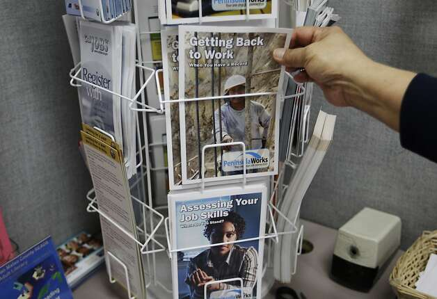 In this Feb. 14, 2012 photo, a job seeker looks for work at JobTrain employment center in Menlo Park, Calif. The number of people seeking unemployment benefits fell to the lowest point in almost four years last week, the latest signal that the job market is steadily improving.  (AP Photo/Paul Sakuma) Photo: Paul Sakuma, Associated Press