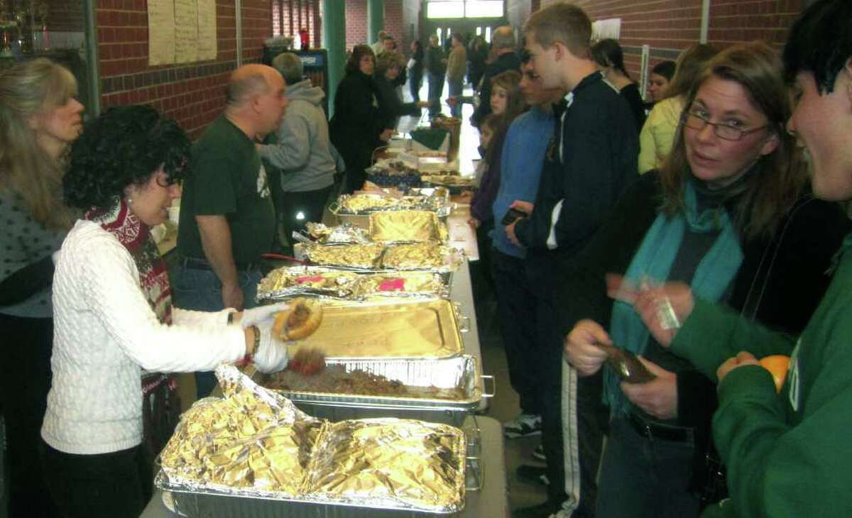 SPECTRUM/The place to be during a break in the action at the South-West Conference wrestling tournament was the buffet table hosted by boosters of the New Milford High School wrestling team. Feb. 12, 2012