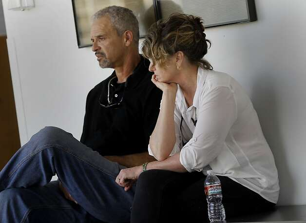 The parents of Daniel DeWitt, Candy (right) and Al DeWitt waited for court proceedings to begin. Berkeley hills slaying suspect Daniel Jordan DeWitt was arraigned Wednesday February 22, 2012 for the bludgeoning of Peter Cukor in an Oakland, Calif. courtroom. Photo: Brant Ward, The Chronicle