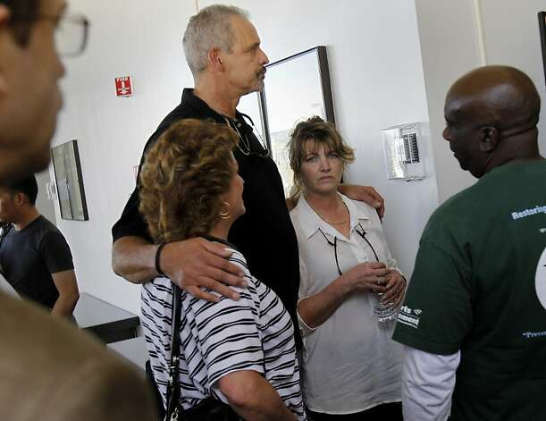 The parents of Daniel DeWitt, Al Dewitt (center) and Candy DeWitt (right of Al) waited to go into the courtroom. Berkeley hills slaying suspect Daniel Jordan DeWitt was arraigned Wednesday February 22, 2012 for the bludgeoning of Peter Cukor in an Oakland, Calif. courtroom. Photo: Brant Ward, The Chronicle