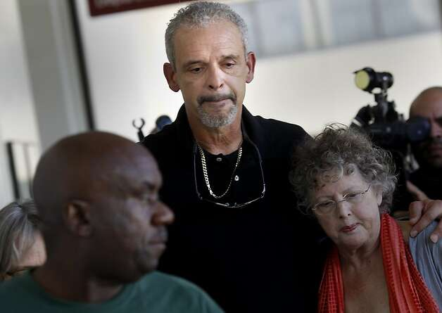 Al DeWitt (center), the father of Daniel DeWitt comforted friends and relatives as he walked down the hallway after the arraignment. Berkeley hills slaying suspect Daniel Jordan DeWitt was arraigned Wednesday February 22, 2012 for the bludgeoning of Peter Cukor in an Oakland, Calif. courtroom. Photo: Brant Ward, The Chronicle