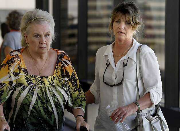 Candy DeWitt (right), the mother of Jordan DeWitt and the boys grandmother (left) left the courtroom after the arraignment. Berkeley hills slaying suspect Daniel Jordan DeWitt was arraigned Wednesday February 22, 2012 for the bludgeoning of Peter Cukor in an Oakland, Calif. courtroom. Photo: Brant Ward, The Chronicle