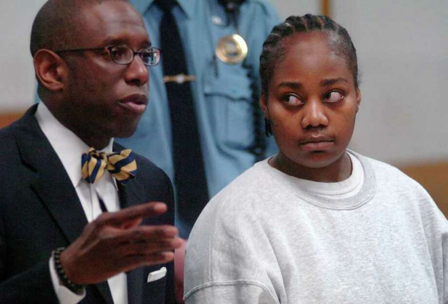 Tanya McDowell stands with her defense attorney, Darnell Crosland, during her appearance in Superior Court in Norwalk, Conn. on Wednesday, Feb. 22, 2012. McDowell, the Bridgeport mom arrested  in April 2011 and charged with first-degree larceny for sending her then 5-year-old son to a Norwalk elementary school, will serve five years in prison and another five years of probation after pleading guilty to the larceny charge. McDowell will be issued a 12-year sentence suspended after five years. She also pleaded guilty to four counts of sale of narcotics -- counts that will be included in her prison sentence. Photo: Erik Trautmann/The Hour/Pool Pho, Erik Trautmann/The Hour/Pool Pho / Connecticut Post Contributed(C)2011, The Hour Newspapers, all rights reserved