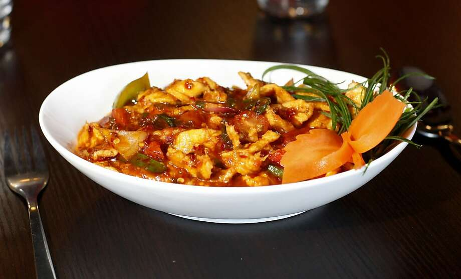 This is Red Hot Chilli Pepper's speciality dish, the Devil's Chicken, that includes the worlds hottest pepper, the ghost pepper. Red Hot Chilli Pepper is an Indian-Chinese fusion restaurant located in San Carlos, Cal. Photo: Sean Culligan, The Chronicle