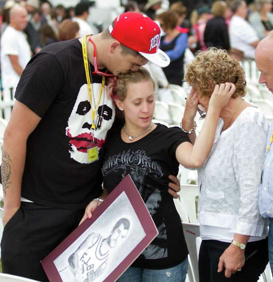 Families grieve for those they lost during a remembrance service in Hagley Park in Christchurch on February 22, 2012, one year after a 6.3 quake hit New Zealand's second largest city. Photo: MARTY MELVILLE, AFP/Getty Images / AFP