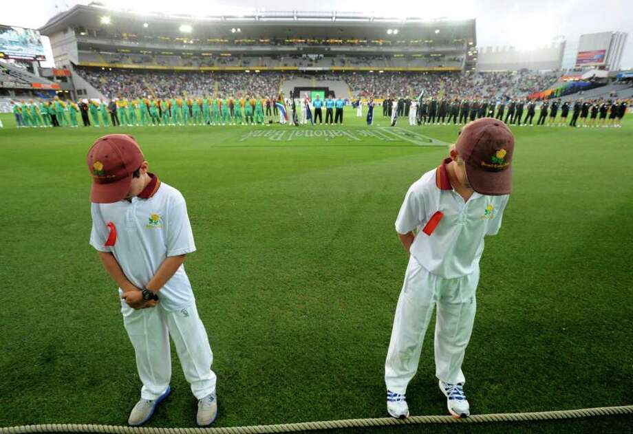Young cricketers join New Zealand's and South Africa's team for a moment of silence to remember those killed in the Christchurch earthquake a year ago, at the third Twenty20 cricket international, at Eden Park, in Auckland, New Zealand, on Wednesday, Feb. 22, 2012. Photo: Ross Setford, Associated Press / SNPA