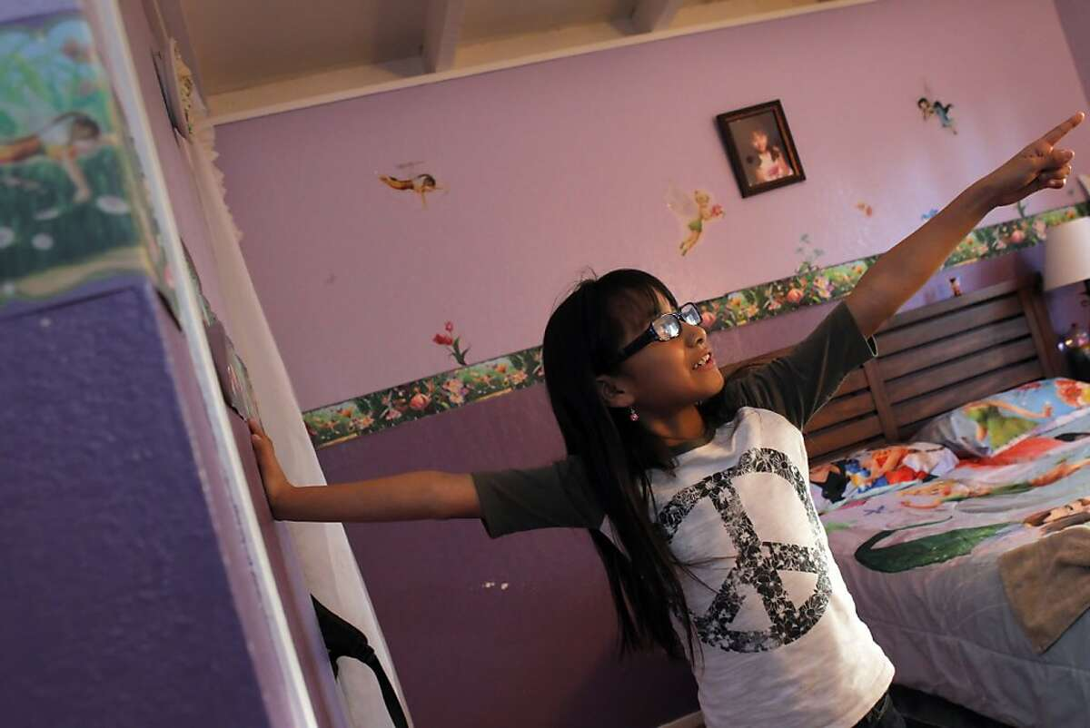 Isabel Luna, 8, shows her Tinkerbell inspired bedroom in her family's San Pablo, Calif., home on Sunday, February 19, 2012. Her father, Oscar Luna, is a delivery driver for BiRite Foodservice Distributors. He moved out of the city to San Pablo about a year ago after he and his wife had their second child and they couldn't afford a larger place in San Francisco.