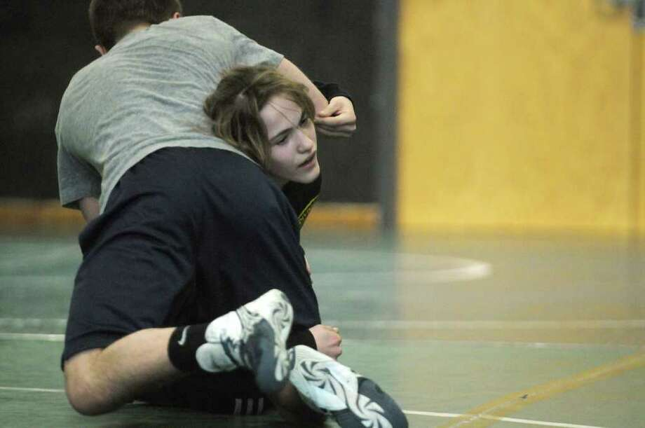 Alexis Bleau from Schoharie High School wrestles Kyle Greene from Columbia High School during a practice for the New York State High School wrestling tournament at Schalmont High School on Monday, Feb. 20, 2012 in Rotterdam, NY.  (Paul Buckowski / Times Union) Photo: Paul Buckowski