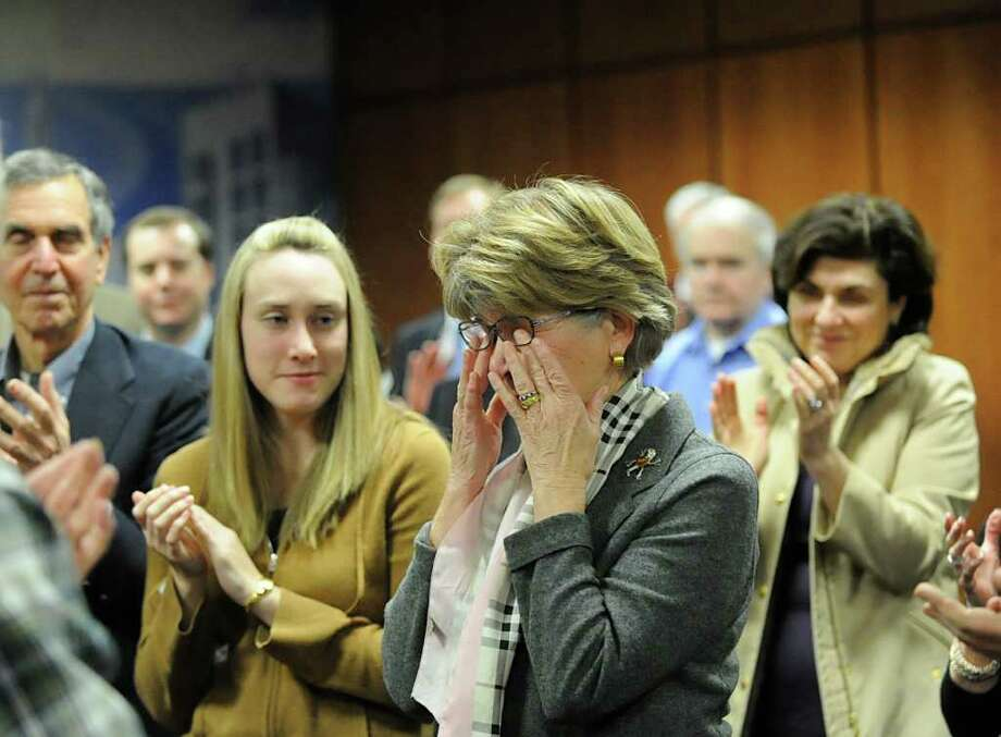 Longtime incumbent state Rep. Lile Gibbons, right, R-150th District, gets a standing ovation after announcing that she will not seek re-election during the Republican Town Committee meeting at Greenwich Town Hall, Wednesday night, Feb. 22, 2012. Photo: Bob Luckey / Greenwich Time