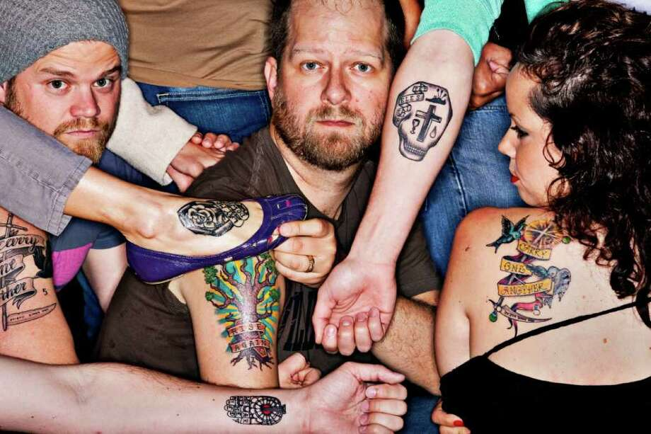 Designer Scott Ericson, left,  and Pastor Chris Seay join other members at Ecclesia Church who have gotten tattoos representing the Stations of the Cross as a part of an art installation for Lent called Cruciformity: Stations on Skin. Photo: Eric Kayne / © 2011 Eric Kayne