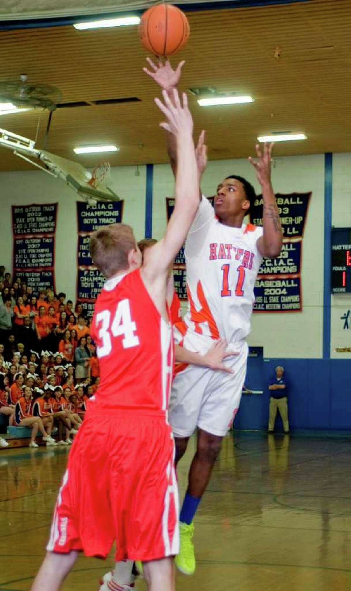 Danbury High School's Timothy Jackson releases the ball against Greenwich High School during a game at Danbury. Wednesday, Feb. 22, 2012