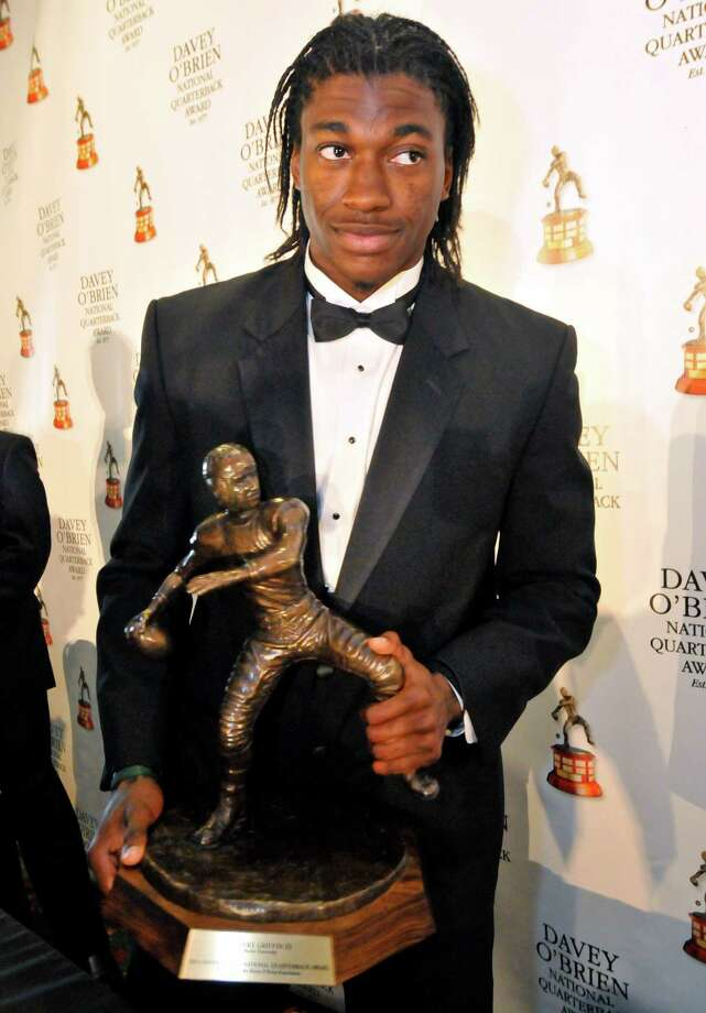 Former Baylor quarterback Robert Griffin III stands with the Davey O'Brien Award, given to the nation's top collegiate quarterback, during a news conference at the awards dinner in Fort Worth, Texas, Monday, Feb. 20, 2012. (AP Photo/Fort Worth Star-Telegram, Max Faulkner) MAGS OUT Photo: Max Faulkner, AP / Fort Worth Star-Telegram