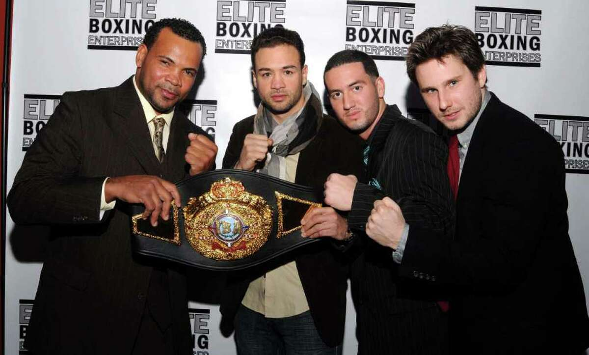 A reception was held at Danbury Billiards on Federal RD on Thursday Dec. 22, 2011 for Danbury boxer, Delvin Rodriguez, who captured the IBA Intercontinental title in the Junior Middleweight Division on Dec. 3 at Madison Square Garden. From left, Rodriguez' trainer, Fernely Feliz, Rodriguez, Manager A.J.Galante and strength coach, Matt Patren.