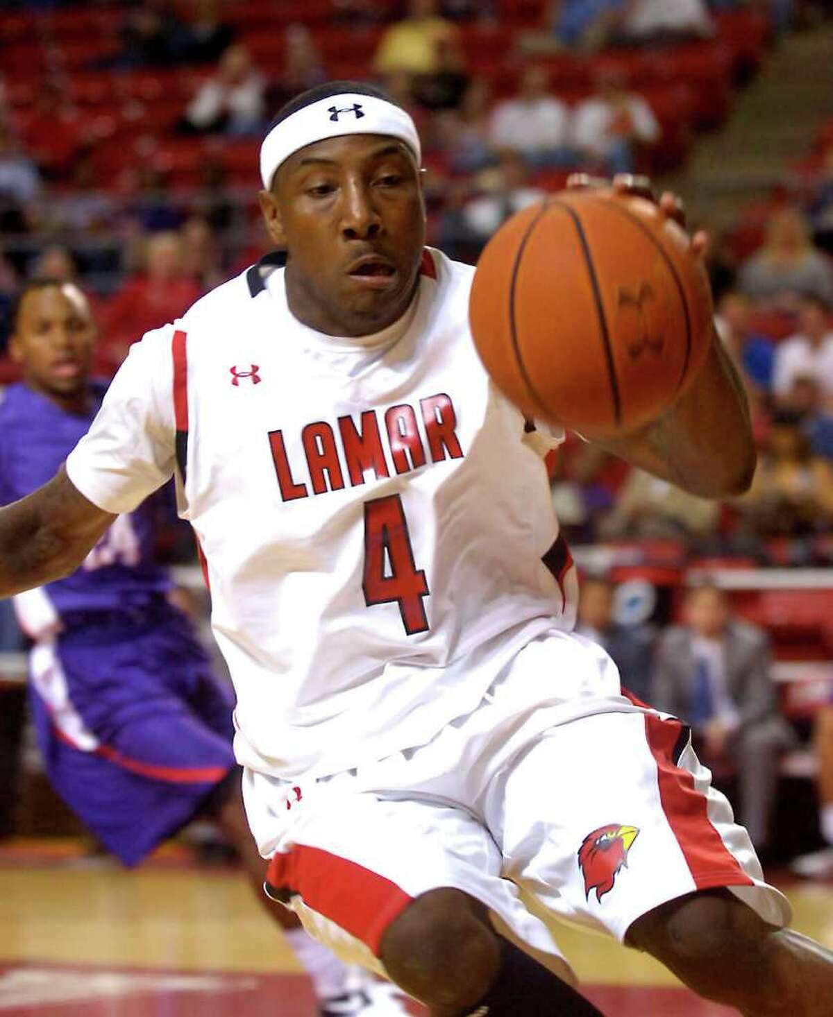 Lamar's Devon Lamb saves a loose ball from going out of bounds during the game against Stephen F. Austin at Lamar Univerisity in Beaumont, Wednesday, February 22, 2012. Tammy McKinley/The Enterprise