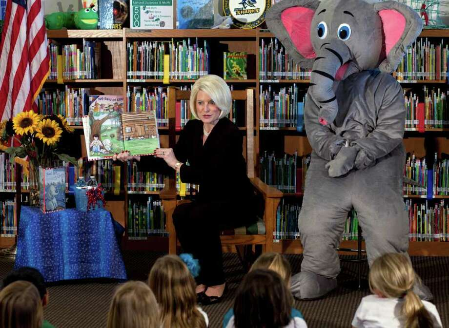 "Callista Gingrich, wife of Republican presidential candidate, former House Speaker Newt Gingrich, reads her book ""Sweet Land of Liberty"" to a group of students in the library at Chaparral Elementary School in Gilbert, Ariz.  Sitting next to Gingrich is a character from her book, Ellis the Elephant. Photo: Mark Henle, Associated Press / The Arizona Republic;Local"