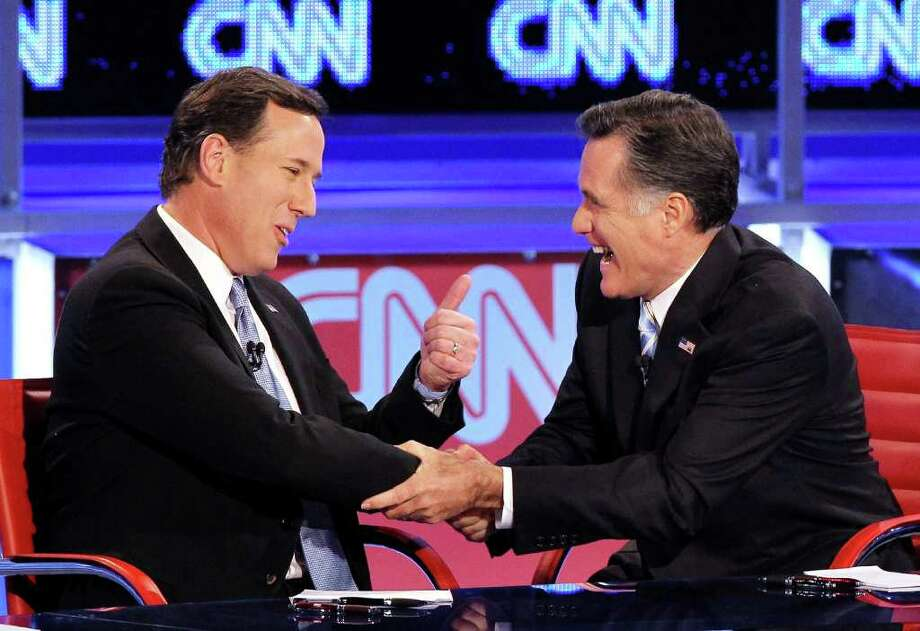 Republican presidential candidates U.S. Rep. former U.S. Sen. Rick Santorum (L) and former Massachusetts Gov. Mitt Romney talk after participating in a debate sponsored by CNN and the Republican Party of Arizona at the Mesa Arts Center February 22, 2012 in Mesa, Arizona. The debate is the last one scheduled before voters head to the polls in Michigan and Arizona's primaries on February 28 and Super Tuesday on March 6. Photo: Justin Sullivan, Getty Images / 2012 Getty Images