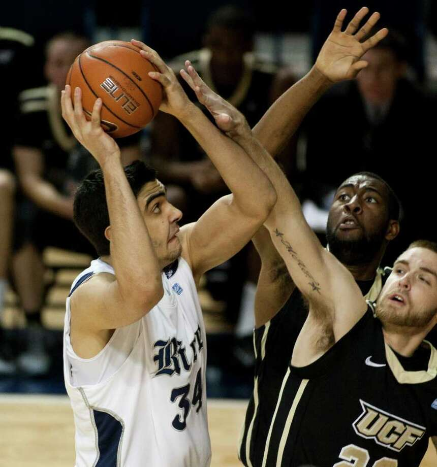 Rice Owls center Omar Oraby, left,  takes a shot during the first half of the NCAA basketball game between the Rice Owls and the UCF Knights at Tudor Fieldhouse in Houston, TX.  Wednesday, Feb. 22, 2012, in Houston. ( Andrew Richardson / For The Chronicle ) Photo: Andrew Richardson, Houston Chronicle / © 2012 Andrew Richardson