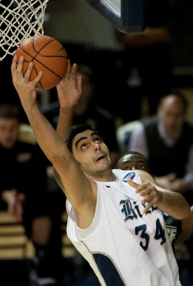 Rice Owls center Omar Oraby (34) makes a basket during the first half of the NCAA basketball game between the Rice Owls and the UCF Knights at Tudor Fieldhouse in Houston, TX.  Wednesday, Feb. 22, 2012, in Houston. ( Andrew Richardson / For The Chronicle ) Photo: Andrew Richardson, Houston Chronicle / © 2012 Andrew Richardson