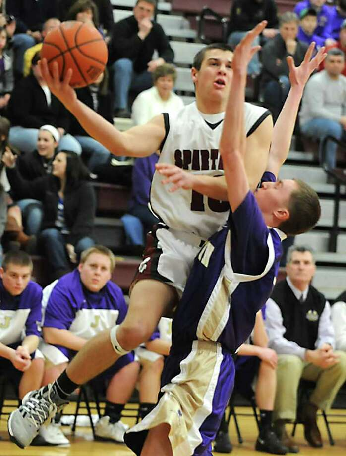 Robert Knightes of Burnt Hills drives to the basket against Cameron Husain of Johnstown during a basketball game Wednesday, Feb. 22, 2012 in Burnt Hills, N.Y.  (Lori Van Buren / Times Union) Photo: Lori Van Buren