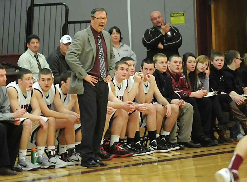 Burnt Hills head coach George Dudas yells from the sidelines during a basketball game against Johnst