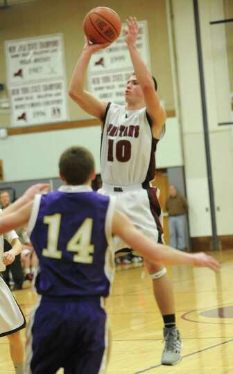 Robert Knightes of Burnt Hills makes a jump shot during a basketball game against Johnstown Wednesda