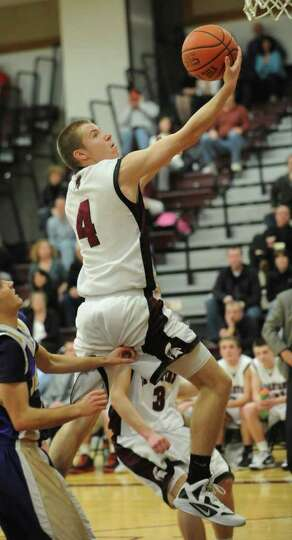 Jayson Sullivan of Burnt Hills goes up for a lay up but misses during a basketball game against John