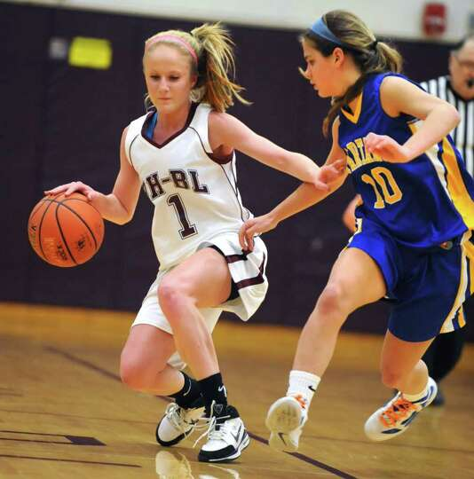 Kaita Albanese of Burnt Hills is guarded by Katelyn Shevlin of Queensbury during a basketball game W